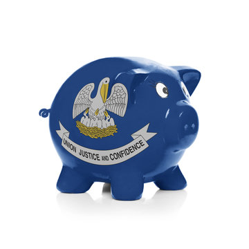 Piggy bank with flag coating over it - State of Louisiana
