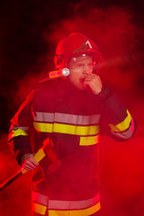 Firefighter shouting in red smoke.