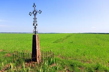 Cross in a grassy field