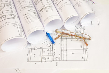 Construction drawings, glasses and pen