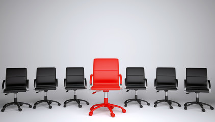 Series of black and one red office chair