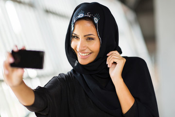 arabian woman taking self portrait