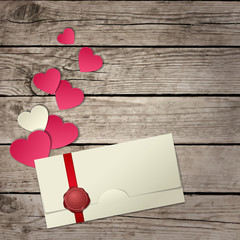 paper hearts and envelope on wooden background