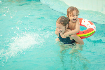 two little kids playing in the pool