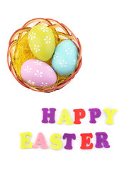 Easter eggs in nest and Happy Easter sign, isolated on white