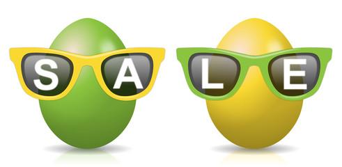 """2 gelb-grüne Ostereier mit Sonnenbrillen mit Schriftzug """"SALE"""""""