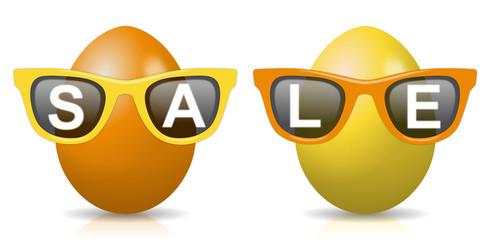 """2 orange-gelbe Ostereier mit Sonnenbrillen und Schriftzug """"SALE"""""""