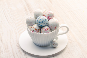 Chocolate Easter eggs in white cup