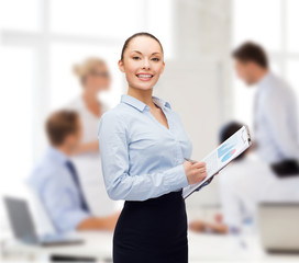 young smiling businesswoman with clipboard and pen