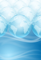 Many globes on a blue background with place for text