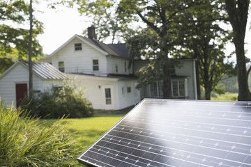 A solar panel in a farmhouse garden.