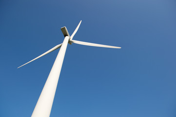 Windmill for wind energy against blue sky