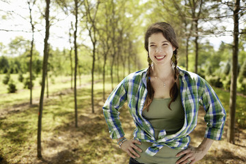 A girl in a green checked shirt with braids.
