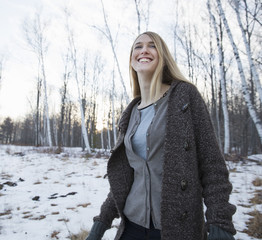 A young woman with long blonde hair outdoors on a winter day.