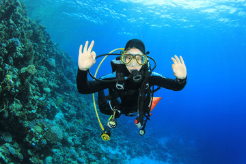 Young woman scuba diving having fun