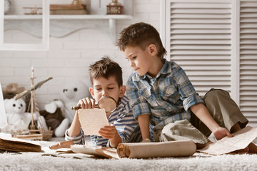 Two boys studying old maps Travel