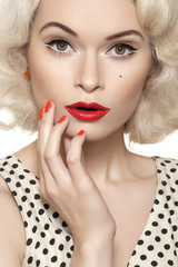Surprise! Pin-up girl with vintage red lips make-up, hairstyle