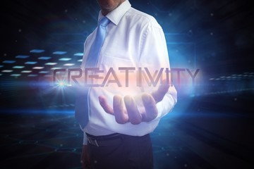 Businessman presenting the word creativity