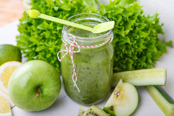 Fresh organic green smoothie with salad, apple, cucumber, pineap