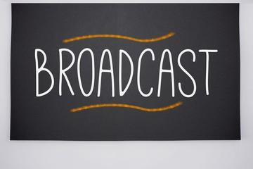 Broadcast written on big blackboard