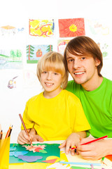 Father teach son to draw