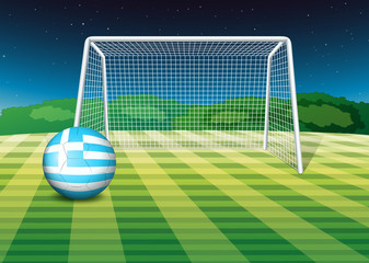 A soccer ball at the field with the flag of Greece