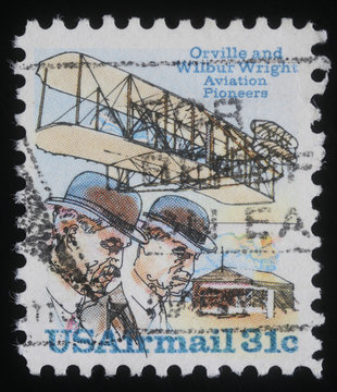 USA stamp showing Wright brothers and Wright Flyer I plane