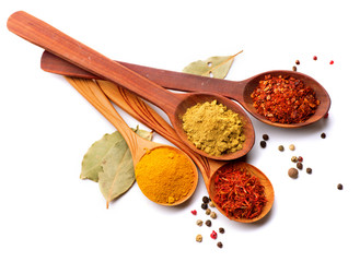 Foto auf AluDibond Gewürze Spices and herbs. Curry, saffron, turmeric, cinnamon over white