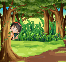 A young girl hiding at the forest