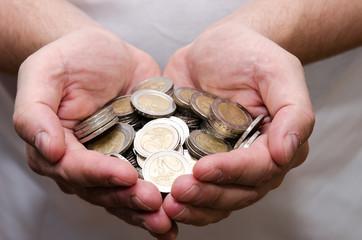 coins in hands