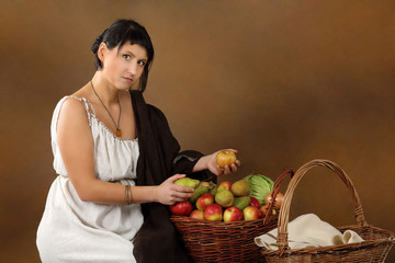Young Romana with basket full of fruits and vegetables