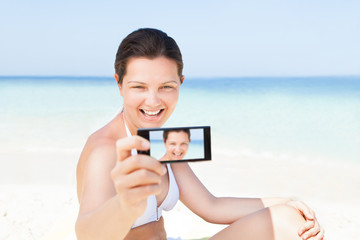 Woman Taking Self Portrait At Beach