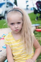 Portrait of beautiful little girlwith long hair