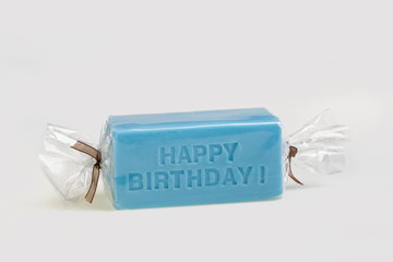 Happy birthday on a blue soap