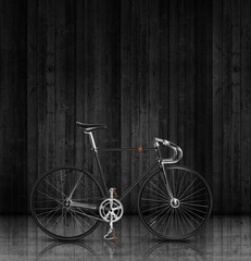 Classic fixed gear bicycle on black wood stage