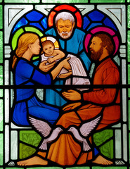 Child Jesus with Mary and Joseph in stained glass