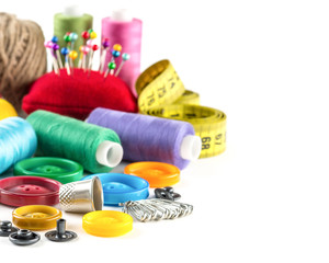 Tools for sewing: measurement, button, thimble, pins