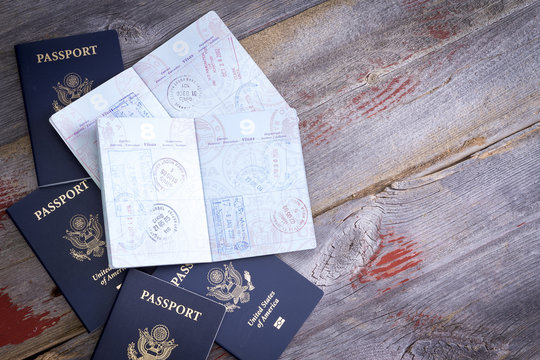 American passports open to reveal stamps