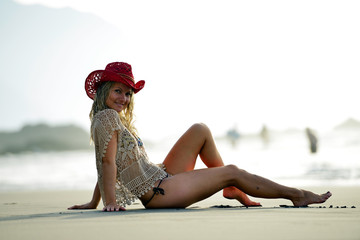 young woman relaxing on the beach in summer
