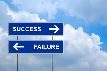 success and failure on blue road sign