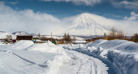 Poster Volcano Koryaksky volcano and surrounding snow-covered countryside