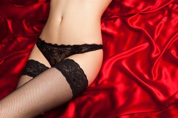 Black lingerie on red silk