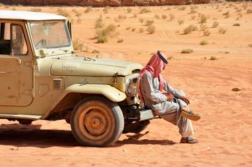 Bedouin setting in his jeep, desert safari in Wadi Rum, Jordan