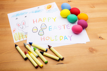 Kid drawing and egg for easter holiday