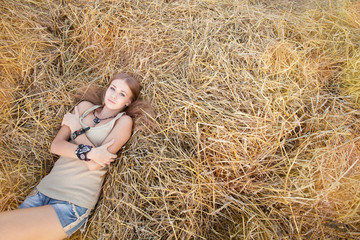 Beauty woman in the straw in field