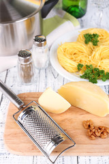 Composition with tasty spaghetti, grater, cheese,