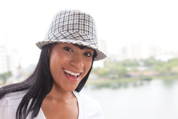 Laughing brazilian woman with hat