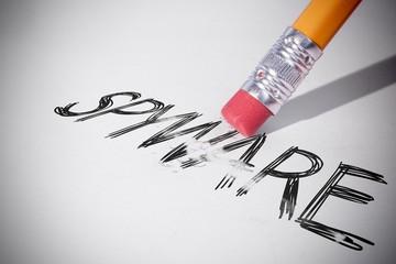 Pencil erasing the word Spyware - fototapety na wymiar