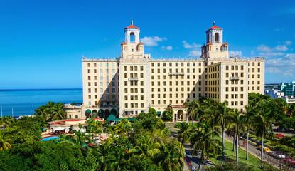 View of Hotel Nacional among green palm trees in Havana. Cuba