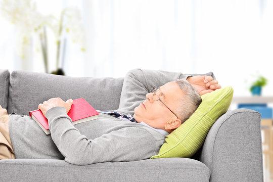 Senior man sleeping on sofa